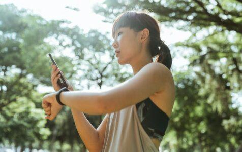 Woman Using Fitness App