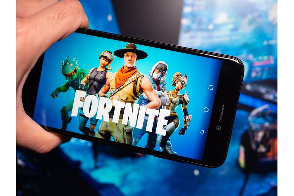 Fortnite blue logo in phone