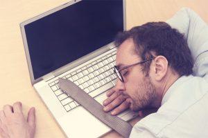 Businessman Sleeping on Laptop
