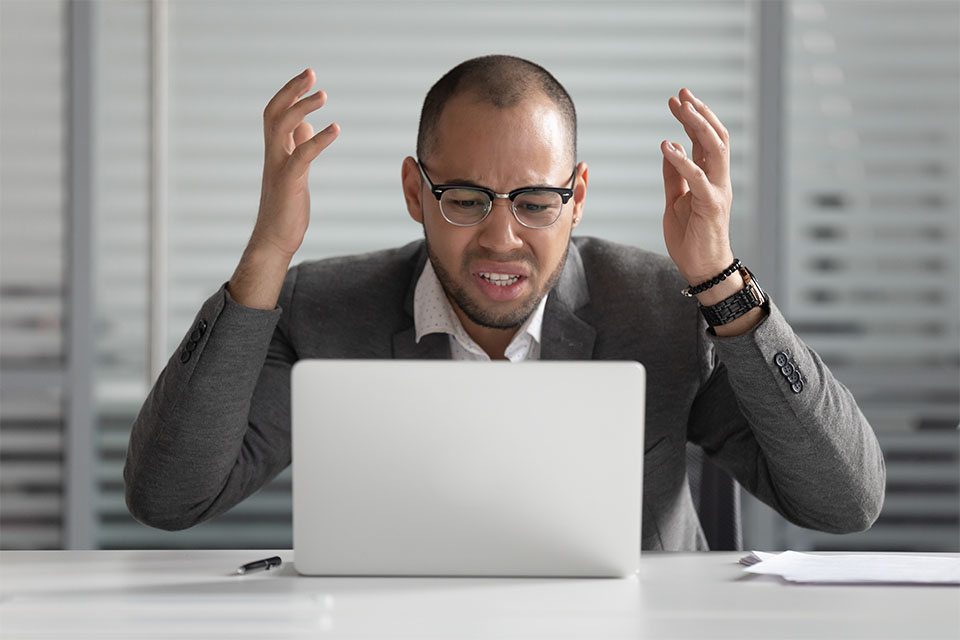 Angry Man Using Laptop