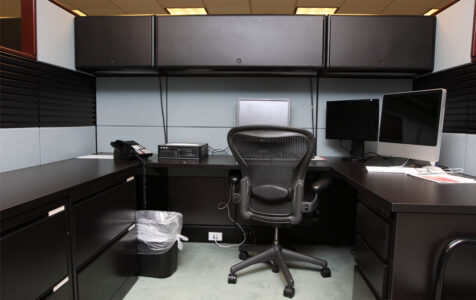 Cubicle in office with Mac Computer
