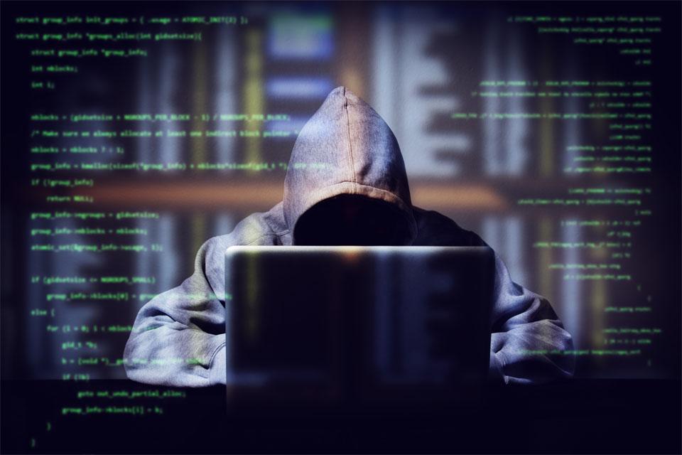 Hacker Working On Computer Code