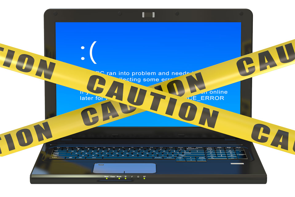 Laptop with Blue Error Screen