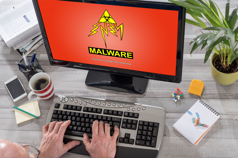 Man Using Computer with Malware