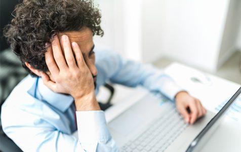 Sad Businessman Using Laptop