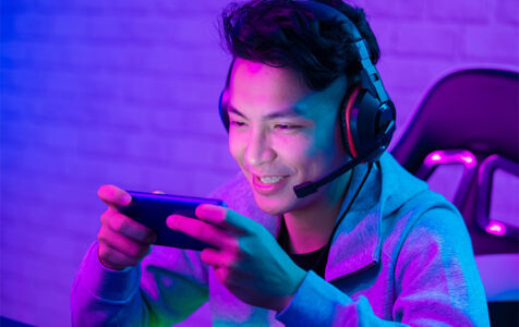 Young Asian Boy Playing Mobile Games