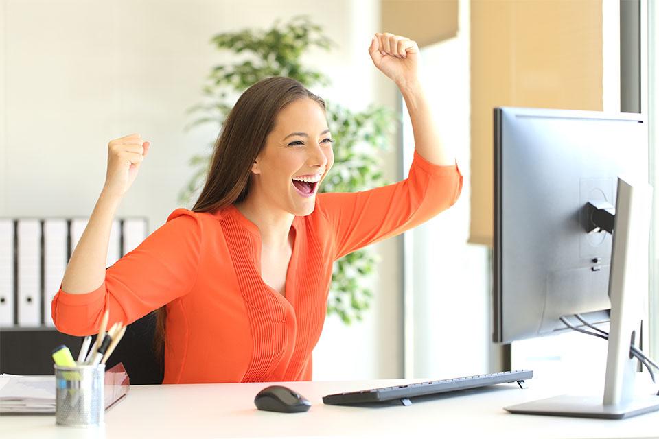 Happy Girl in Front of Computer
