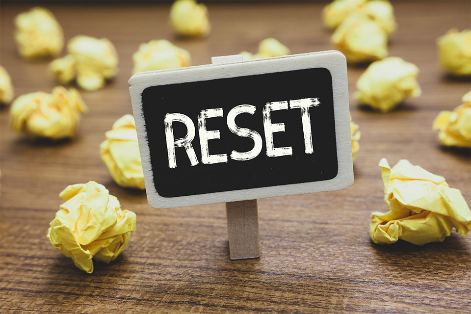 Reset Sign with Crumpled Papers