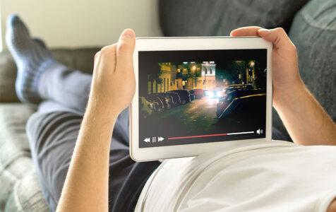 Man Watching Movie in Tablet