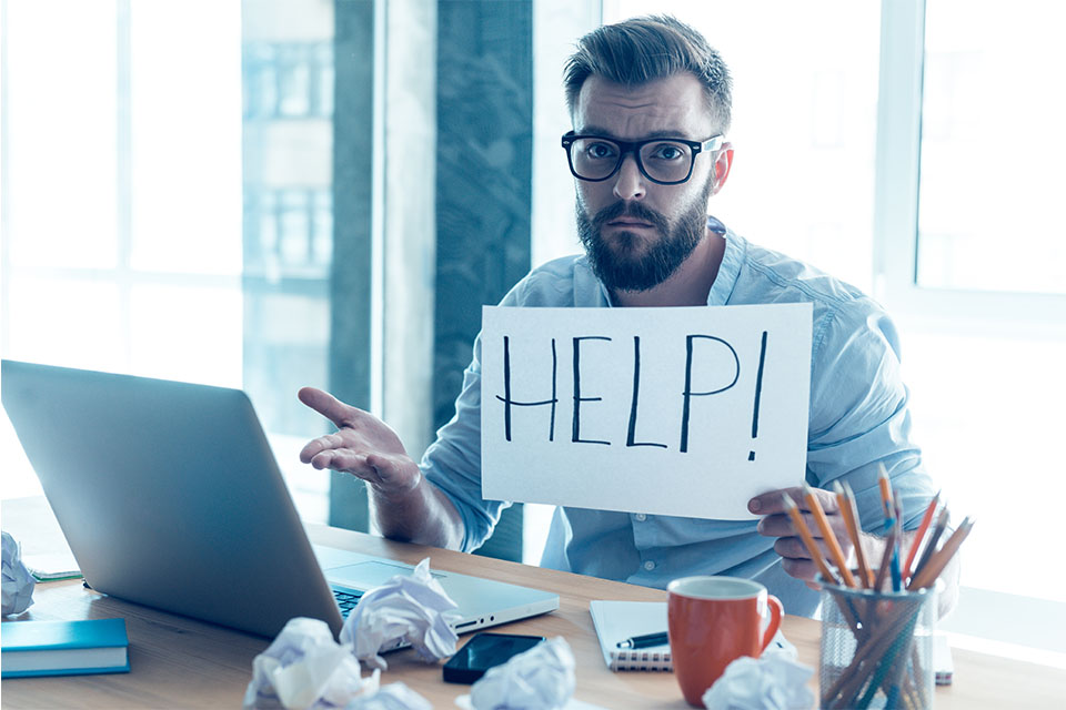 Stressed Man Asking for Help in Front of Computer