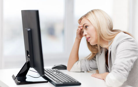 Stressed Woman in Front of Computer